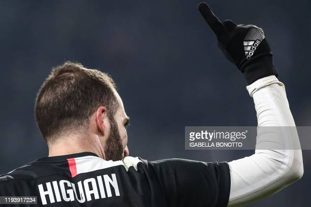 Juventus' Argentinian forward Gonzalo Higuain celebrates after opening the scoring during the Italian Cup round of 16 football match Juventus vs...