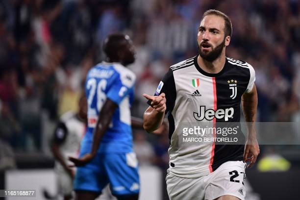 Juventus' Argentinian forward Gonzalo Higuain celebrates after scoring a goal during the Italian Serie A football match Juventus vs Napoli on August...