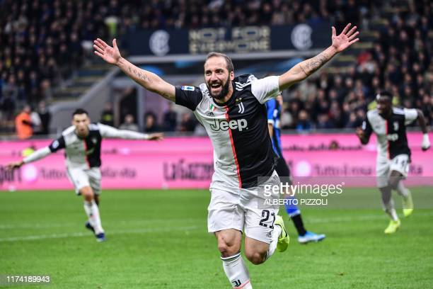 Juventus' Argentinian forward Gonzalo Higuain celebrates after scoring during the Italian Serie A football match Inter vs Juventus on October 6, 2019...