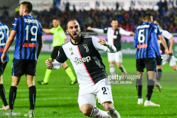 Juventus' Argentinian forward Gonzalo Higuain celebrates after scoring an equalizer during the Italian Serie A football match Atalanta Bergamo vs...