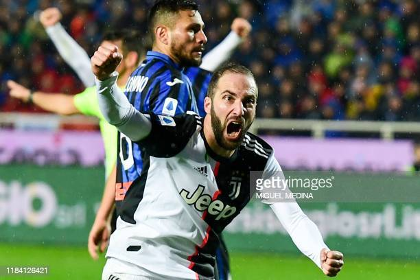 Juventus' Argentinian forward Gonzalo Higuain celebrates after scoring an equalizer during the Italian Serie A football match Atalanta Bergamo vs...