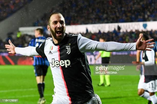 Juventus' Argentinian forward Gonzalo Higuain celebrates after scoring his second goal during the Italian Serie A football match Atalanta Bergamo vs...