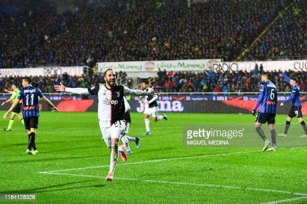 Juventus' Argentinian forward Gonzalo Higuain celebrates after scoring his second goal during the Italian Serie A football match Atalanta Bergamo vs...