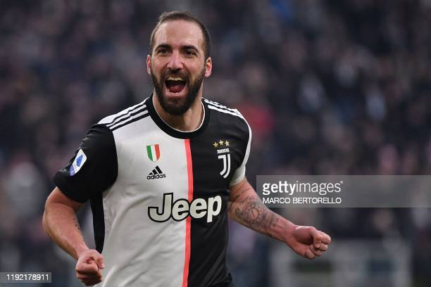 Juventus' Argentinian forward Gonzalo Higuain celebrates after scoring during the Italian Serie A football match Juventus vs Cagliari on January 6...
