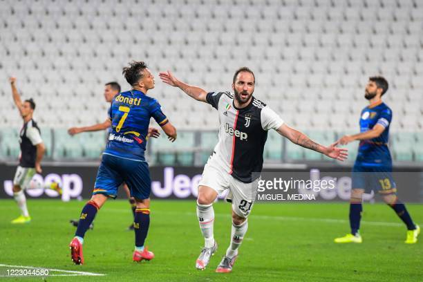 Juventus' Argentinian forward Gonzalo Higuain celebrates after scoring during the Italian Serie A football match Juventus vs Lecce played on June 26,...