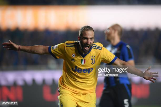 Juventus' Argentinian forward Gonzalo Higuain celebrates after scoring a goal during the Italian Serie A football match between Atalanta and Juventus...