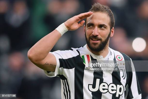 Juventus' Argentinian forward Gonzalo Higuain celebrates after scoring a goal during the Italian Serie A football match between Juventus and Sassuolo...