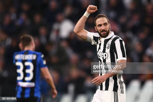 TOPSHOT Juventus' Argentinian forward Gonzalo Higuain celebrates after scoring during the Italian Serie A football match Juventus vs Atalanta on...