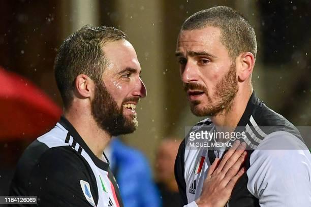 Juventus' Argentinian forward Gonzalo Higuain celebrates with Juventus' Italian defender Leonardo Bonucci after scoring his second goal during the...