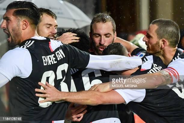 Juventus' Argentinian forward Gonzalo Higuain celebrates with Juventus' German midfielder Emre Can Juventus' Welsh midfielder Aaron Ramsey and...