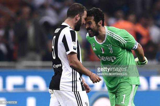 Juventus' Argentinian forward Gonzalo Higuain celebrates with Juventus' Italian goalkeeper Gianluigi Buffon at the end of the Italian Serie A...