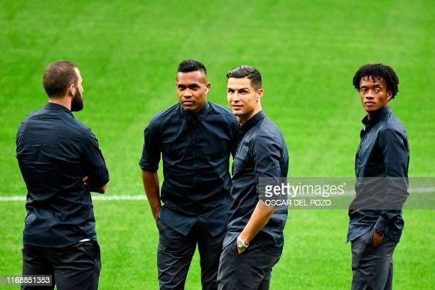 Juventus' Argentinian forward Gonzalo Higuain, Juventus' Brazilian defender Alex Sandro, Juventus' Portuguese forward Cristiano Ronaldo and Juventus'...