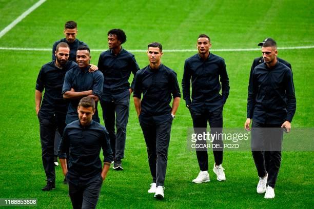 Juventus' Argentinian forward Gonzalo Higuain Juventus' Brazilian defender Alex Sandro Juventus' Colombian midfielder Juan Cuadrado Juventus'...