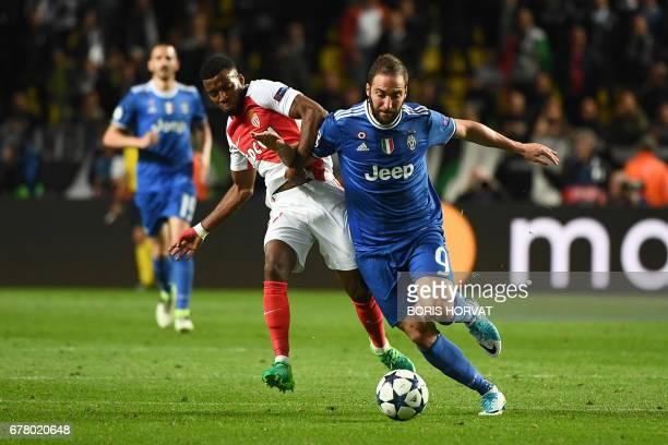 Juventus' Argentinian forward Gonzalo Higuain outruns Monaco's midfielder Thomas Lemar during the UEFA Champions League semifinal first leg football...