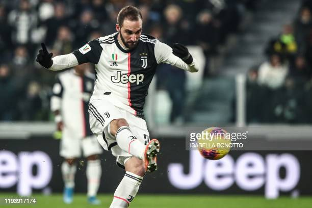 Juventus' Argentinian forward Gonzalo Higuain shoots to open the scoring during the Italian Cup round of 16 football match Juventus vs Udinese on...