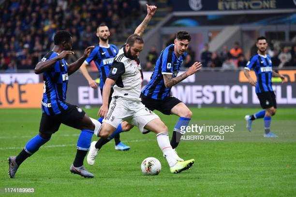 Juventus' Argentinian forward Gonzalo Higuain shoots to score during the Italian Serie A football match Inter vs Juventus on October 6, 2019 at the...