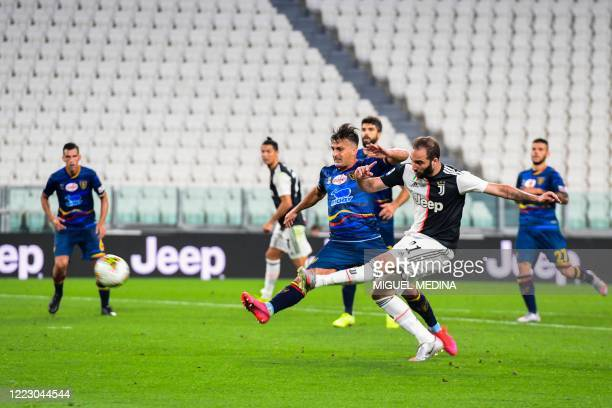 Juventus' Argentinian forward Gonzalo Higuain shoots to score the third goal during the Italian Serie A football match Juventus vs Lecce played on...