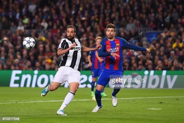 TOPSHOT Juventus' Argentinian forward Gonzalo Higuain vies with Barcelona's defender Gerard Pique during the UEFA Champions League quarterfinal...