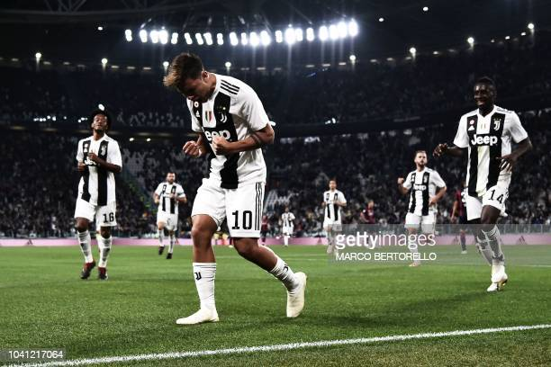 Juventus' Argentinian forward Paulo Dybala celebrates after scoring a goal during the Italian Serie A football match between Juventus and Bologna on...