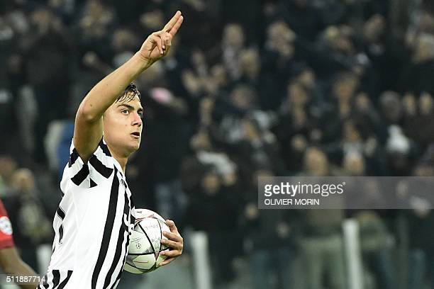 Juventus' Argentinian forward Paulo Dybala celebrates after scoring a goal during the UEFA Champions League round of 16 first leg football match...