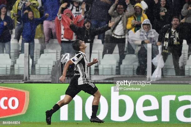 Juventus' Argentinian forward Paulo Dybala celebrates after scoring during the Italian Serie A football match Juventus vs Chievo at the Allianz...