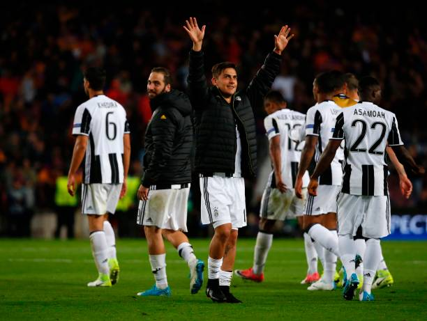 Juventus' Argentinian forward Paulo Dybala celebrates their qualification for the semis at the end of the UEFA Champions League quarter-final second...
