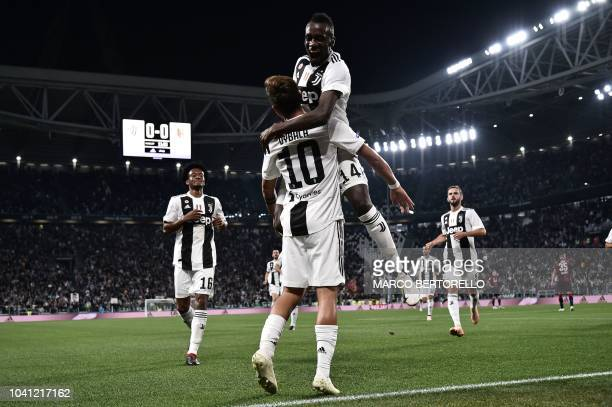Juventus' Argentinian forward Paulo Dybala celebrates with Juventus French midfielder Blaise Matuidi after scoring a goal during the Italian Serie A...