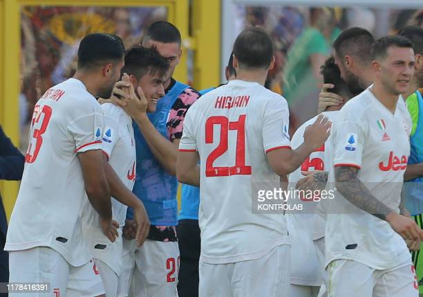 STADIUM LECCE PUGLIA ITALY Juventus' Argentinian forward Paulo Dybala celebrates with teammates after scoring a penalty during the Italian Serie A...