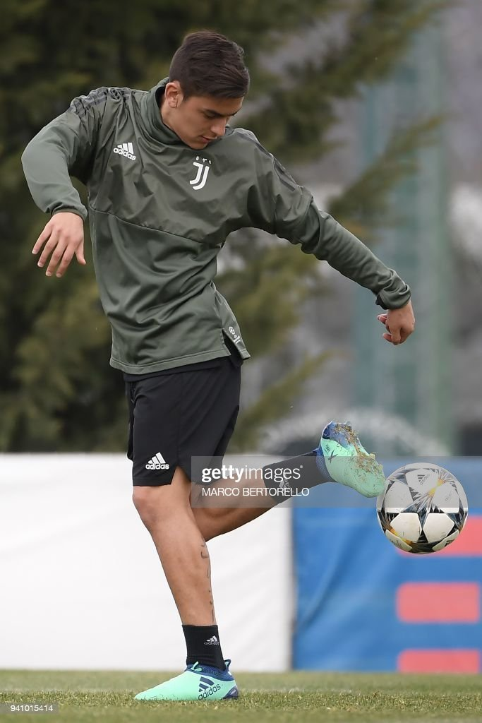 Juventus' Argentinian forward Paulo Dybala controls a ball during a training session on the eve of the UEFA Champions League football match Juventus vs Real Madrid on April 2, 2018 at the Juventus training center in Vinovo. /