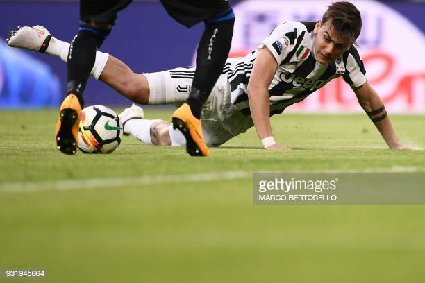 Juventus' Argentinian forward Paulo Dybala falls during the Italian Serie A football match Juventus vs Atalanta on March 14 2018 at the Allianz...