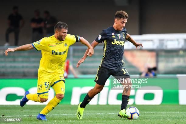 Juventus' Argentinian forward Paulo Dybala outruns Chievos Finnish midfielder Perparim Hetemaj during the Italian Serie A football match AC Chievo vs...