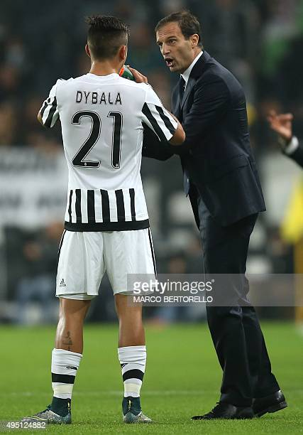 Juventus' Argentinian forward Paulo Dybala talks with Juventus' coach Massimiliano Allegri during the Italian Serie A football match Juventus Vs...