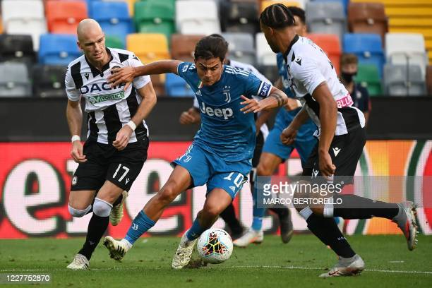 Juventus' Argentinian forward Paulo Dybala vies for the ball with Udinese's Dutch defender Bram Nuytinck and Udinese's Nigerian defender William...