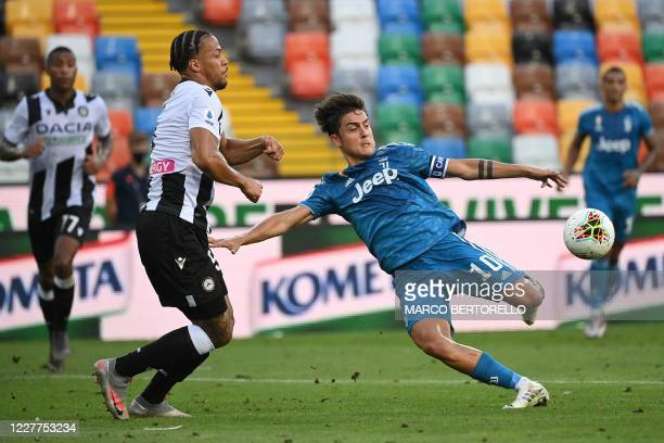 Juventus' Argentinian forward Paulo Dybala vies for the ball with Udinese's Nigerian defender William TroostEkong during the Italian Serie A football...