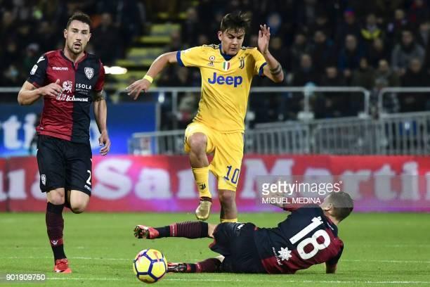 Juventus' Argentinian forward Paulo Dybala vies with Cagliari's Italian midfielder Nicolo Barella during the Italian Serie A football match between...
