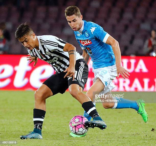 Juventus' Argentinian forward Paulo Dybala vies with Napoli's Brazilian midfielder Jorginho during the Italian Serie A football match SSC Napoli vs...