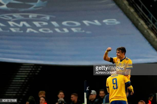 Juventus' Argentinian striker Paulo Dybala celebrates scoring their second goal during the UEFA Champions League round of sixteen second leg football...