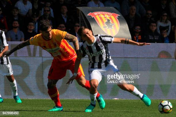 Juventus' Argentinian striker Paulo Dybala fights for the ball with Benevento's Italian midfielder Nicolas Viola during the Italian Serie A football...