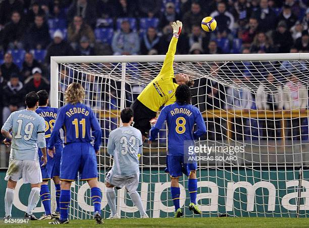 Juventus Austrian goalkeeper Alexander Manninger tries to stop a goal scored by Lazio's Argentine midfielder Cristian Ledesma during the Italian...