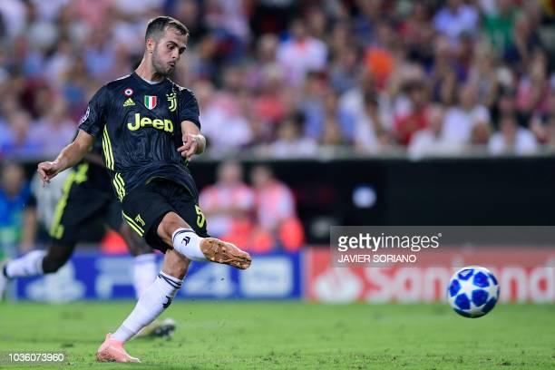 Juventus' Bosnian defender Miralem Pjanic scores a penalty during the UEFA Champions League group H football match between Valencia CF and Juventus...