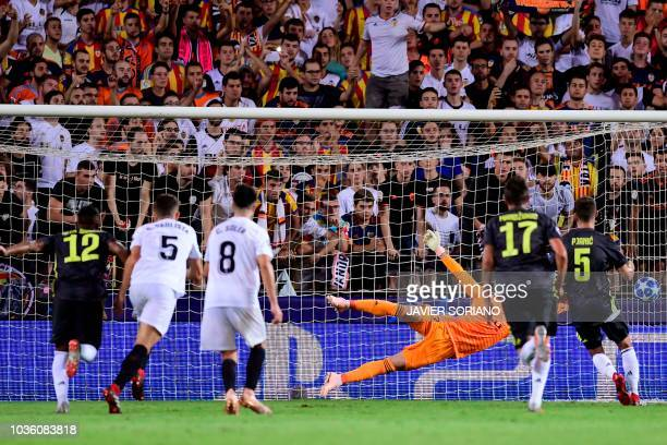 Juventus' Bosnian defender Miralem Pjanic scores during the UEFA Champions League group H football match between Valencia CF and Juventus FC at the...
