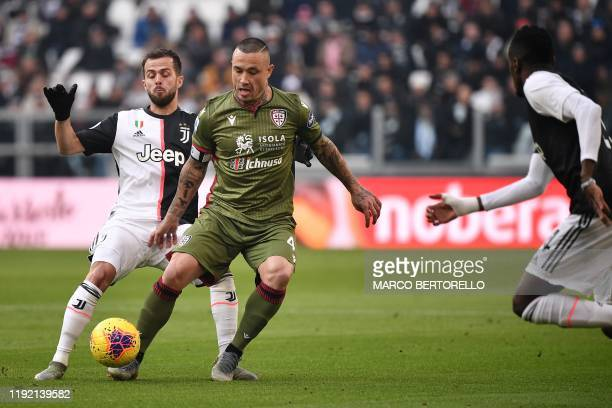 Juventus' Bosnian midfielder Miralem Pjanic and Cagliari's Belgian midfielder Radja Nainggolan go for the ball during the Italian Serie A football...
