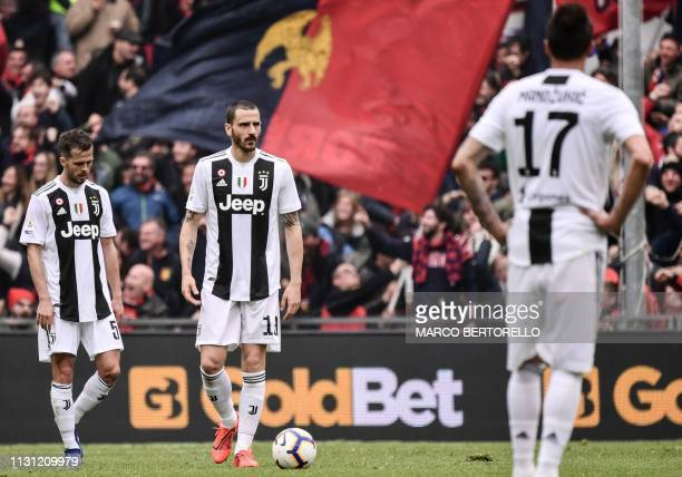 Juventus' Bosnian midfielder Miralem Pjanic and Juventus' Italian defender Leonardo Bonucci react after Juventus conceded a goal during the Italian...
