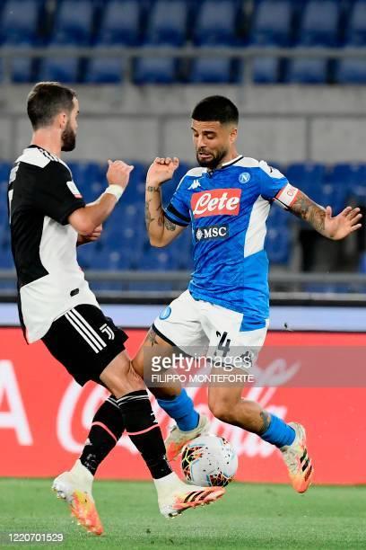 Juventus' Bosnian midfielder Miralem Pjanic and Napoli's Italian forward Lorenzo Insigne collide during the TIM Italian Cup final football match...