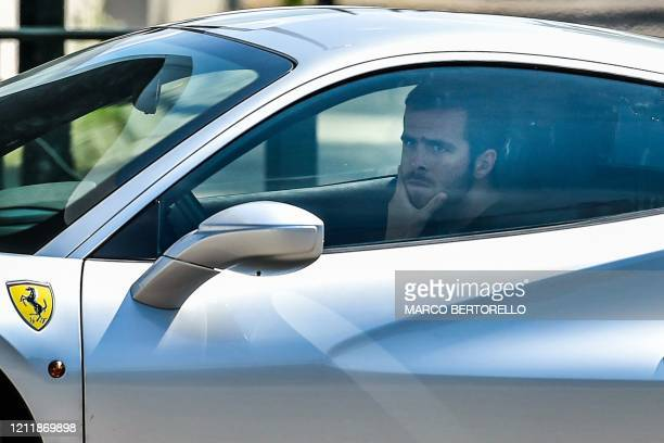 Juventus' Bosnian midfielder Miralem Pjanic arrives in his car at the Juventus' Continassa training ground in Turin on May 5 during the country's...