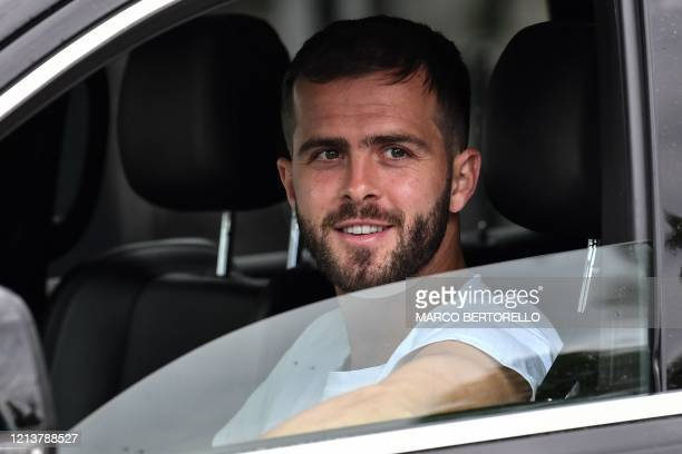 Juventus' Bosnian midfielder Miralem Pjanic arrives in his car to attend training on May 19, 2020 at the club's Continassa training ground in Turin,...