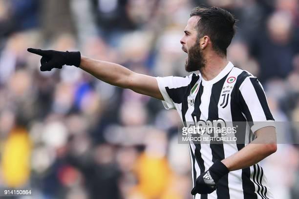Juventus' Bosnian midfielder Miralem Pjanic celebrates after scoring a goal during the Italian Serie A football match between Juventus and Sassuolo...