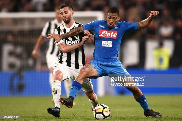 Juventus' Bosnian midfielder Miralem Pjanic fights for the ball with Napoli's Brazilian midfielder Allan during the Italian Serie A football match...