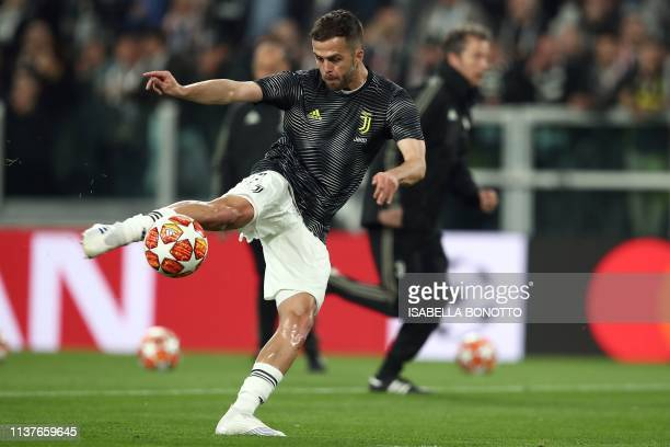 Juventus' Bosnian midfielder Miralem Pjanic kicks the ball during warm up prior to the UEFA Champions League quarterfinal second leg football match...