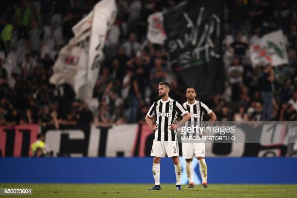 Juventus' Bosnian midfielder Miralem Pjanic reacts at the end of the Italian Serie A football match between Juventus and Napoli on April 22 2018 at...